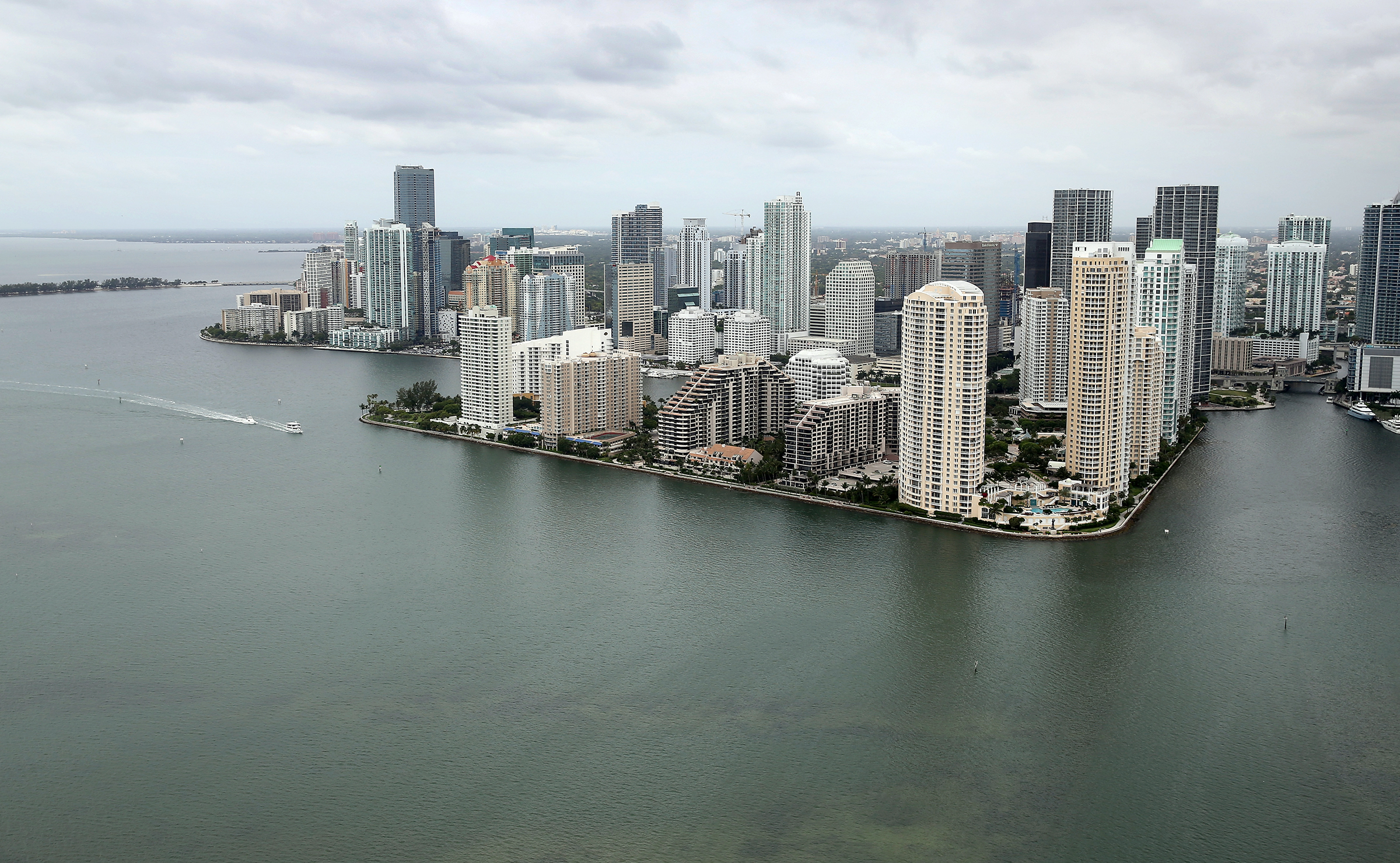 MIAMI, FL - JUNE 03:  Waterfront condo buildings are seen June 3, 2014 in Miami, Florida. According to numerous scientists, south Florida could be flooded by the end of the century as global warming continues to melt the Arctic ice, in turn causing oceans to rise. U.S. President Barack Obama and the Environmental Protection Agency yesterday announced a rule that would reduce the nation's biggest source of pollution, carbon emissions from power plants, 30% by 2030 compared to the 2005 levels.  It is widely believed that these emissions are a main cause of global warming. (Photo by Joe Raedle/Getty Images)