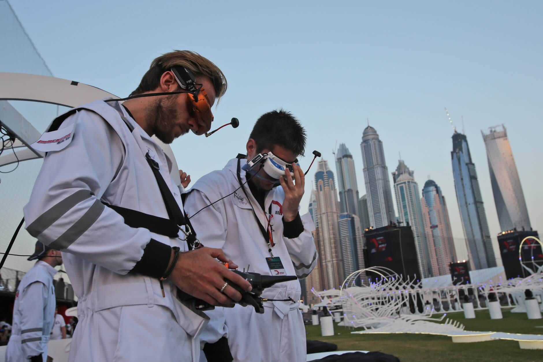 Fill Freybott, pilot of Freybott team of Germany, left, controls their team drone during the final day of the first World Drone Prix in Dubai, United Arab Emirates, Saturday, March 12, 2016. (AP Photo/Kamran Jebreili)