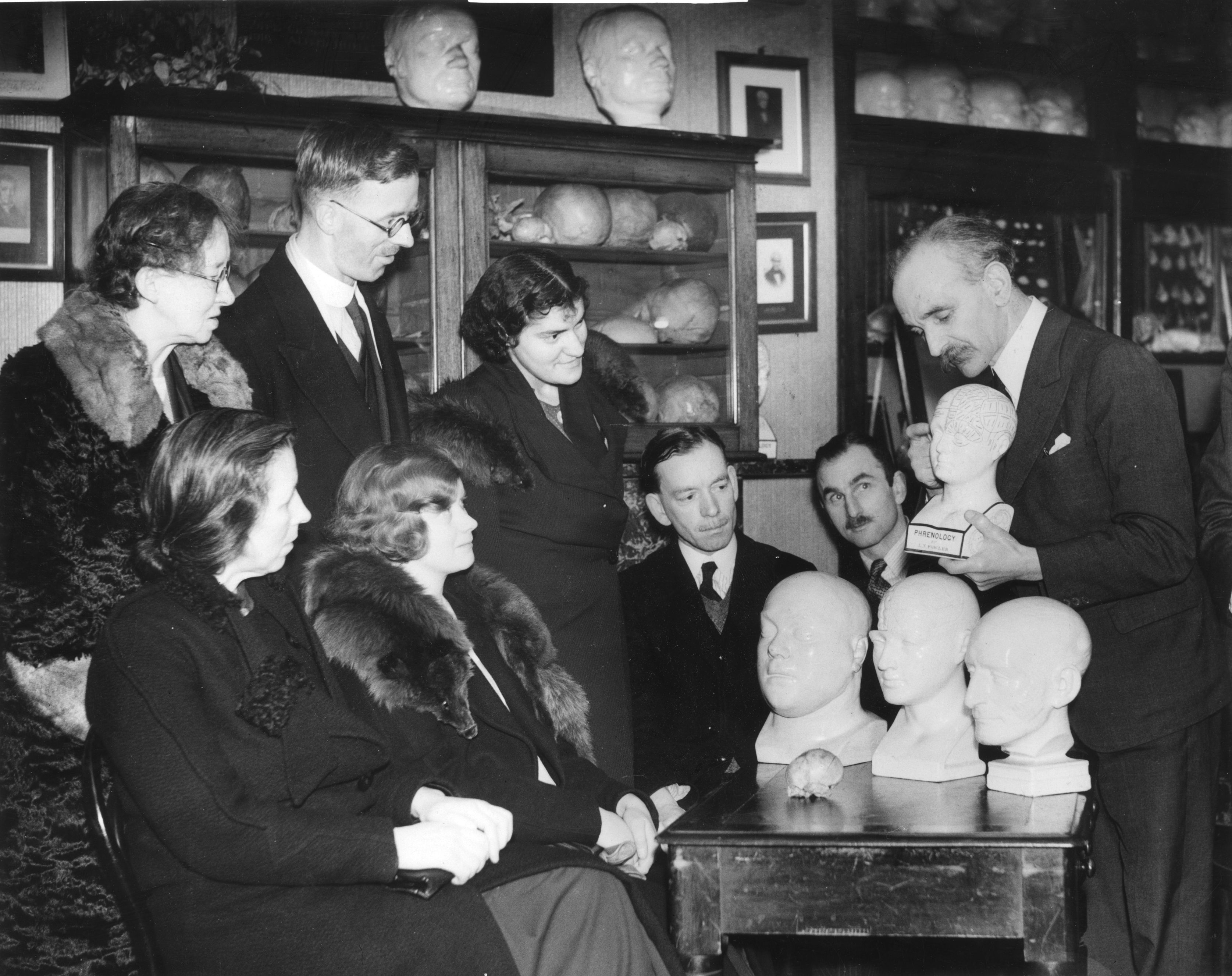 27th January 1937:  J L Barr demonstrating phrenology techniques during a  course which teaches pupils to 'read' the bumps on a person's head.  (Photo by Reg Speller/Fox Photos/Getty Images)